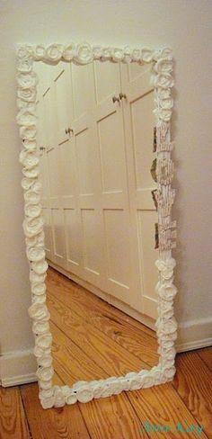 hot glue artificial flowers around mirror; cute!