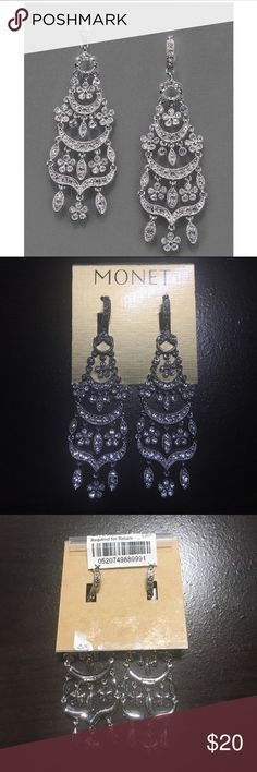 Monet Chandelier Earrings This delicate design is crafted in silver tone metal and crystals, light in weight adding movement to the earrings for a soft alluring look.  Earrings feature lever back closure for pierced earrings. These gorgeous earrings have never been worn- brand new! Monet Jewelry Earrings