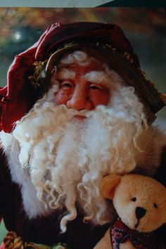 OOAK Victorian Santa with hand sculpted Premo Sculpey face.  I made this one in 2011 and I believe it was my first Santa I sold on line on Etsy.  TK