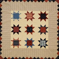 Make a patriotic tabletop quilt featuring stars and stripes prints from the American Patriot collection by Faye Burgos for Marcus Fabrics. Frame the quilt with prairie points in coordinating prints.