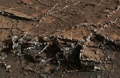 A photograph of Mars from above looking at the rough terrain taken on March 18, 2015. This area is known as Garden City for the way the rocks are making random formations, you can also see different colors in the rock because of the minerals left over from what ever life was on here.