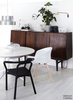 Mid-century credenza in a dining space in a delightful home in Finland / Riika Kantinkoski