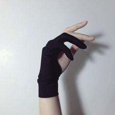 Looks like an archery glove...