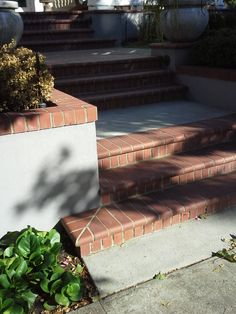 concrete formed stairs and retaining wall with brick toppers and bullnosed treads