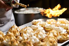 Matbilder food photography of meringues being flamed #matbilder #foodphotography #artisan #advertisingphotography  #lifestylephotography #baking #cooking #flame #meringue