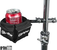 It's a can holder! Drummers get thirsty too! This little accessory gadget mounts off to the side of the drums or percussion set up and allows the drummer to reach over for a quick sip in between songs.   http://store.drumbum.com/skuA-154.html