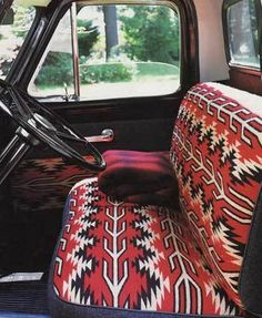 A cozy farm truck. - love that seat cover!