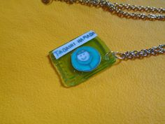 Baymax inspired healthcare chip necklace by TinkerGirlBoutique