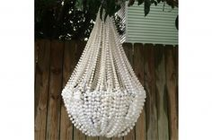 DIY Mardi Gras Bead Chandelier | Back Bayou Vintage - another great use of mardi gras beads