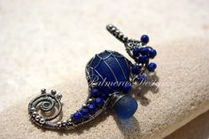NAVY BLUE seahorse wire wrapped seaglass by PalmerasDesign on Etsy, $180.00