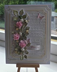 Handmade card with flowers and brick embossing folder