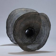 'Laissez entrer le soleil #8 (Let the sunshine in #8)' (2012) by French wood artist and sculptor Pascal Oudet (b.1972). Sandblasted tree rings, 22 x 17 x 22 cm. source: the artist's site. via Artweek LA