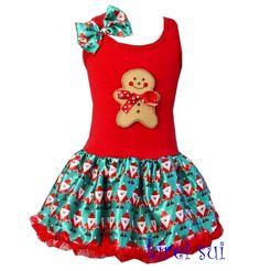 Peperkoekman, Gingerbread op een jurk in rood en groen met bedrukte satijnen rok met Kerstprint.