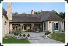 Jack Arnold. Backyard patio, stone terrace, stunning windows