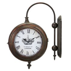 Wall-mounted train station-style clock with an antiqued brass finish.