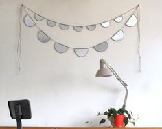 Love the idea of hanging this where you would be able to see yourself...where light would bounce. So cute! :: Mirror Bunting Small Half Circle Banner Garland by fluxglass