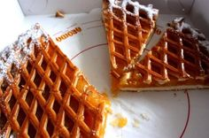 10 Dutch Foods You Should Try at Least Once - Awesome Amsterdam  A delicious pie with a tasty light crust, Limburgse vlaai is often filled with fruits like cherries or apricots. This type of pie is originally from the Limburg area in the south of the Netherlands