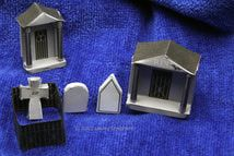 Miniature headstones, fence and mausoleums for a Halloween village graveyard. - Photo © 2012 Lesley Shepherd