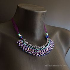 This beading tutorial is for a fashionable, geometric tribal bib beaded necklace – lightweight and airy – perfect for summer!