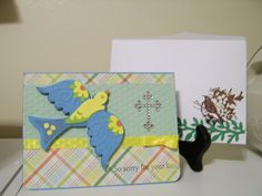 Bird cut with Floral Embellishment Cricut cartridge; Rhinestone Cross, Hobby Lobby; Pattern Paper, DCWV Fresh Floral Stack; Envelope Bird is Heat embossed and the vine is the Martha Stewart Vine Trim Double Edge punch