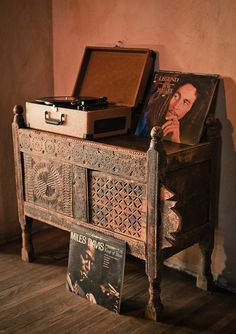 .I want a record player so badly  so that I can play all my old vinyl. This would be so sweet for chad and I, music sessions where we can connect by just talking about music which chad loves the most. Also love this table stand.