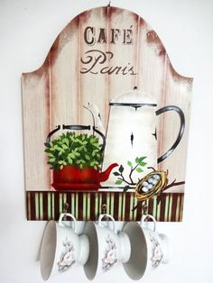 Porta-xícaras confeccionada em mdf trabalhada com pintura artística, aplicação de stencil, e técnica de envelhecimento com proteção de verniz especial. <br> <br>Decora sua cozinha ou aquele cantinho especial destinado a degustação de uma bela xícara de café junto aos amigos ou ao ser amado. <br> <br>Além de decorar seu ambiente, esta peça possui 3 ganchinhos próprios para pendurar delicadas xícaras de café. <br> <br>Obs. As xícaras que aparecem na foto são elementos meramente decorativos…