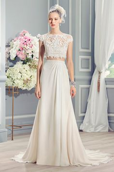Crop tops and wedding gowns might sound like they don't belong together in the same sentence, but Moonlight Bridal's tasteful design is totally wearable. A covered-up neckline and simple silhouette add balance to an otherwise non-traditional ensemble.
