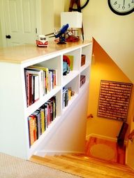 Very cool split foyer with build in bookshelves!