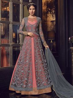 Beautiful pink partywear gown suit online which is crafted from net fabric with exclusive embroidery and stone work. This stunning designer gown suit comes with net dupatta. Costumes Anarkali, Anarkali Dress, Anarkali Suits, Long Anarkali, Lehenga Suit, Indian Gowns Dresses, Pink Gowns, Pakistani Dresses, Net Dresses