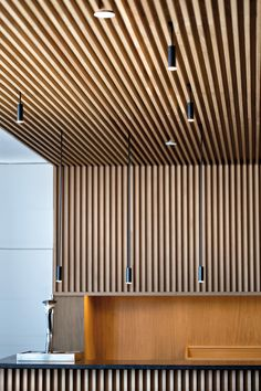 Delicate arches and simple cylinders in a family of lights which can be used singly or in clusters of brilliance. Aluminum heads with acrylic diffusers. Wood Slats, House Design, Wood Slat Wall, Office Interior Design, Small Entryways, Timber Ceiling, Wood Slat Ceiling, Ceiling Design, Wooden Ceilings
