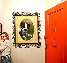 Amy Sedaris' apartment: Painted wall frame, and an Eddie dog!