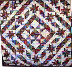 New England Log Cabin made by Joanne Wilhelm from the pattern in Stellar Quilts by Judy Martin.