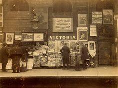 London 1896: A platform at Victoria Underground station, depicting the familiar railway newsstand at dawn. #Victorian #vintage #streets #UK
