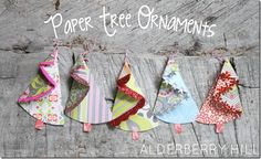 Paper Tree Ornaments - Alderberry Hill - So cute and super simple to make using leftover scrapbook paper. Hang on dead tree branches. Creative Christmas Trees, Cone Christmas Trees, Handmade Christmas Tree, Christmas Holidays, Christmas Decorations, Christmas Ornaments, Christmas Paper, Paper Decorations, Tree Crafts
