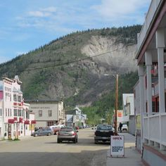 Dawson City, Yukon  Camp 20 mins east of town at the territorial campground for under $20, across from airport. Pay showers at edge of town in trailer park if needed.
