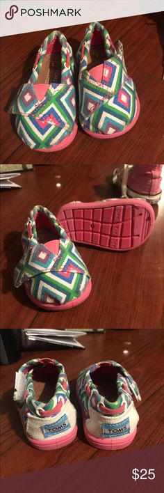 Infant TOMS. HEADS UP NEW MAMAS!! Do NOT buy your new babies brand new items, they will grow so fast they'll never put them on. NEVER WORN!! Brand new TOMS. Infant Size 3. Super super cute. Baby girl literally skipped this size and never put them on, along with a pink pair I will post later. TOMS Shoes Baby & Walker