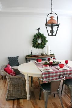 Christmas Decorating The Inspired Room Dining Room like the Christmas pillow.  plaid tablecloth and wreath