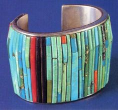 Cuff | Charles Loloma. (Hopi Pueblo). Sterling silver inlaid with turquoise, coral and iron wood (?)