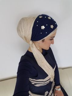 """Let It Snow These Let It Snow are comfy and cozy and oh so perfect for the snowy weather. Cover your ears and keep your head warm with a pretty, unique style. These headbands have pearls sprinkled all over and snowflake/flower shapes around some pearls as well. Button it in the back and Voila no extra accessories needed. Every women's dream come true. Tichel Styling Tip: In a hurry but want to look beautiful and unique? Wrap your tichel in a basic tie and place the """"Let It Sn"""