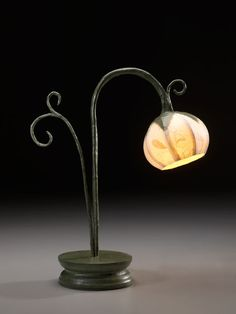 Single stem flower lamp with accents on small round base. $120.00, via Etsy.