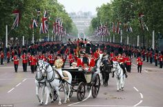 Members of the Household Guard march behind the Barouche carrying the Queen and Prince Philip during the Trooping the Colour