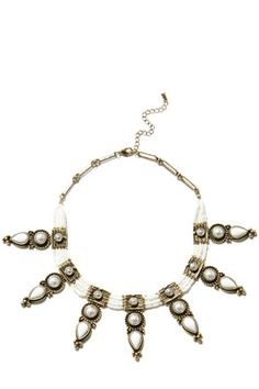 This statement necklace features an enamel and bead details in an Aztec design