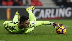 Sunderland goalkeeper Mannone grabs the ball midway through the first half at the Stadium of Light