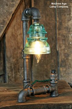 Steampunk Lamp Vintage Industrial Insulator • Amazing industrial iron pipe lamp • Made from one key-less chandelier light socket and a vintage light green power line insulator • $349.99 Vintage style twisted Electrical Cord-green. There is 3 1/2 feet of cord with black on/off twist knob. One 15 watt light bulb is included lamp stands 13 inches tall. Lamp was assembled using all UL approved products.