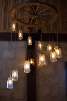 Spiral Wagon Wheel Mason Jar Chandelier. I like the concept but would prefer art glass shades instead of mason jars.