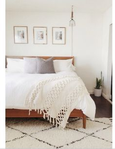 Moroccan shag rug, wood bed frame, and a gorgeous blanket. So simple and pretty!