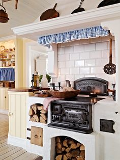 <3 Not a fan of the subway tile, but I LOVE the raised fireplace/woodstove.