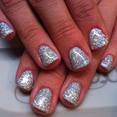 Gelish with halographic glitter pressed in.