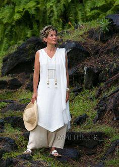 white linen sleeveless summer tunic and beige sarouel skirt