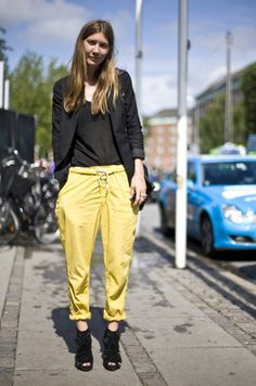 Emily Johannsen, Copenhagen // Black ACNE Jacket, Sheer RODEBJER T-Shirt, Yellow Rolled Up ACNE Carrot Pants, and Black CHRISTIAN LOUBOUTIN Shoes